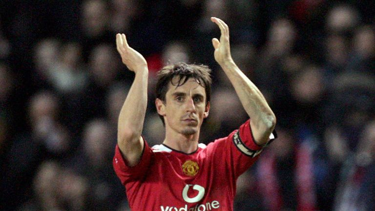 Manchester United captain Gary Neville applauds the crowd after defeating Blackburn Rovers in their English League Cup match at Old Trafford in Manchester, 25 January 2006.