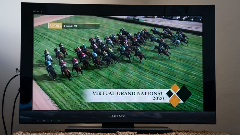 Sport Coronavirus - Saturday April 4th The Virtual Grand National on a TV in a flat in Wandsworth.