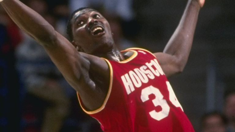 Hakeem Olajuwon corrals a rebound against the Milwaukee Bucks