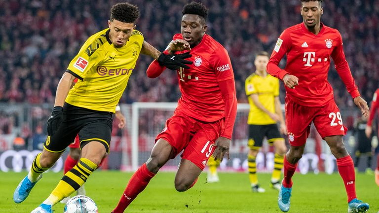 Jadon Sancho takes on Alphonso Davies at the Allianz Arena