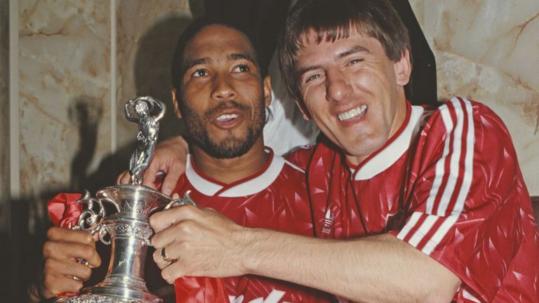 John Barnes and Peter Beardsley with the First Division trophy