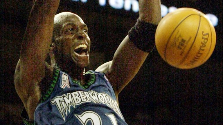 Kevin Garnett throws down a two-handed  slam for the Minnesota Timberwolves