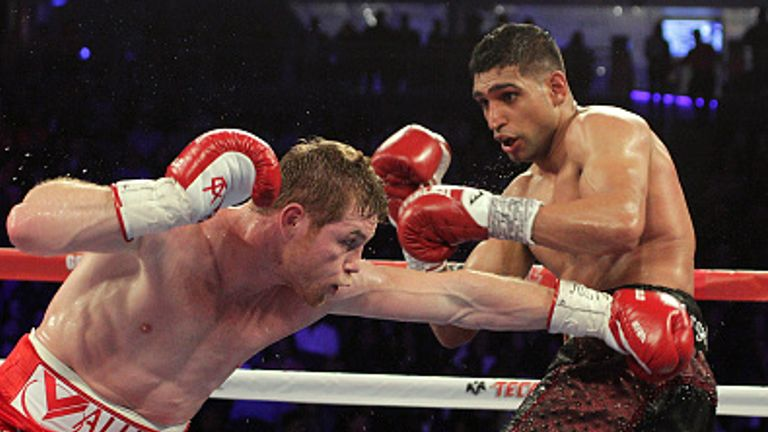 Saul Canelo Alvarez beats  Amir Khan in their WBC Middleweight Championship fight in 2016 in Las Vegas