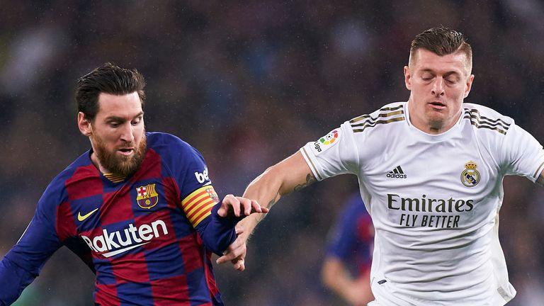 Lionel Messi in action alongside Toni Kroos