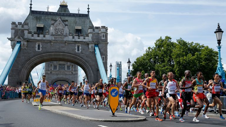 The runners pass under the iconic Tower Bridge in the London Marathon