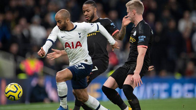 Lucas Moura of Tottenham Hotspur and Oleksandr Zinchenko and Raheem Sterling of Manchester City during the Premier League match at Tottenham Hotspur Stadium