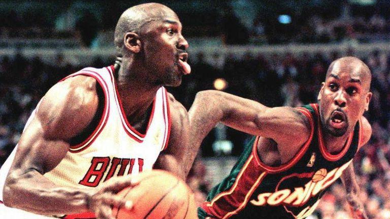 Michael Jordan drives by Gary Payton in the 1996 NBA Finals