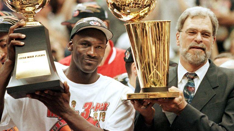 Michael Jordan and Phil Jackson celebrate the Chicago Bulls 1998 NBA championship victory