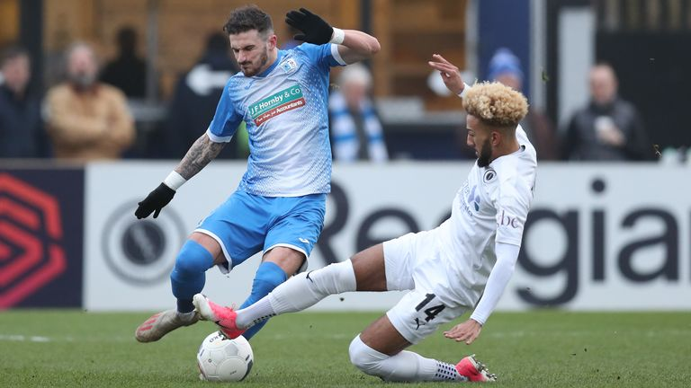 Boreham Wood's Sorba Thomas and Brad Barry of Barrow in National League action in January