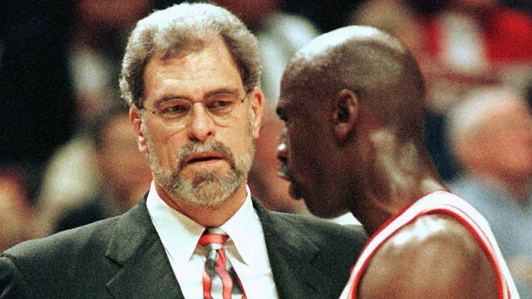 Phil Jackson shares a word with Michael Jordan in the 1997 NBA Finals