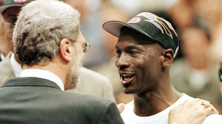 Phil Jackson and Michael Jordan celebrate the Bulls' victory in the 1998 NBA Finals