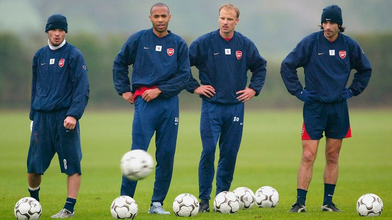 LONDON - APRIL 30:  Freddie Ljungberg (L), Thierry Henry, Dennis Bergkamp, and Robert Pires (R) line up to practise free kicks during the Arsenal Football Club training session at London Colney training ground on April 30, 2004 in London.  (Photo by Paul Gilham/Getty Images) *** Local Caption *** Freddie Ljungberg;Thierry Henry;Dennis Bergkamp;Robert Pires