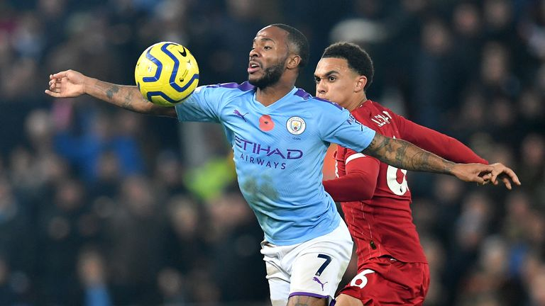 Manchester City's English midfielder Raheem Sterling (L) vies with Liverpool's English defender Trent Alexander-Arnold (R) during the English Premier League football match between Liverpool and Manchester City at Anfield in Liverpool, north west England on November 10, 2019.