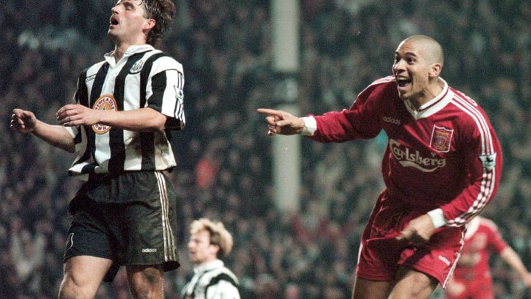 Stan Collymore celebrates after his dramatic winner as Newcastle players look dejected