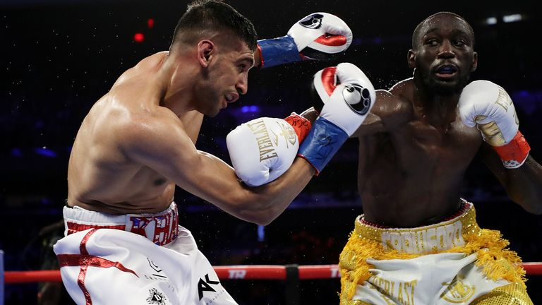 Crawford stopped Khan in their welterweight title fight