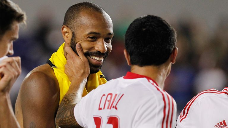 Cahill celebrates a win with New York Red Bulls' Thierry Henry in September 2012