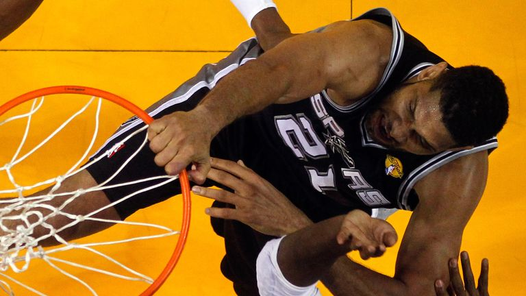 Tim Duncan rams home a dunk for the Spurs against the Miami Heat in the NBA Finals