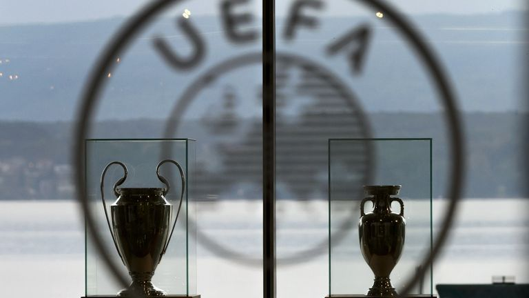 Champions League and European Cup trophies are seen at UEFA headquarters in Nyon, Switzerland