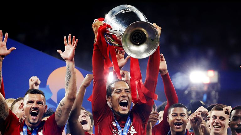 Van Dijk celebrates lifting the Champions League trophy after victory in the 2019 final against Tottenham