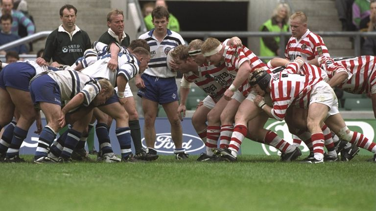 Wigan and Bath's forwards pack down for a scrum in the union leg