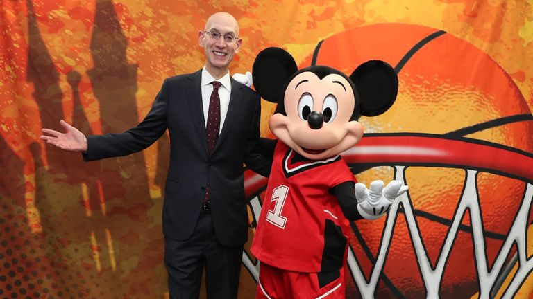 NBA commissioner Adam Silver poses with Mickey Mouse - credit NBA.com