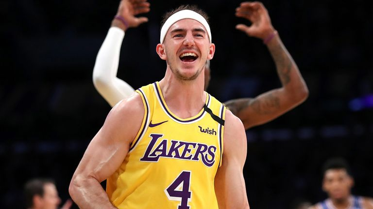 Alex Caruso celebrates a basket during a Lakers-Knicks game