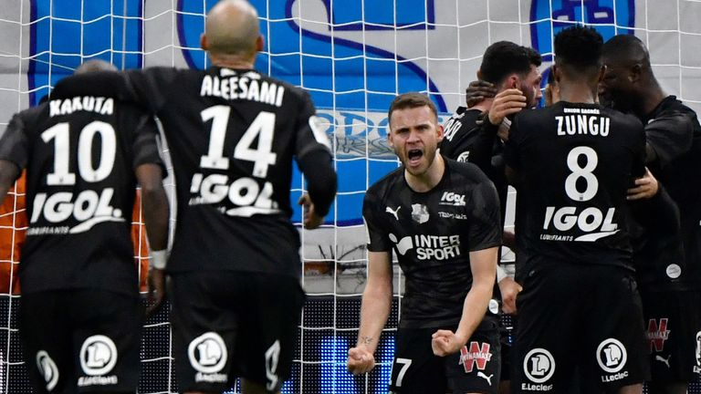Amiens drew away at second-placed Marseille in their final game before the suspension of the Ligue 1 season
