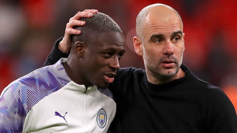 Benjamin Mendy celebrates with Pep Guardiola after the 2-1 Carabao Cup Final win over Aston Villa