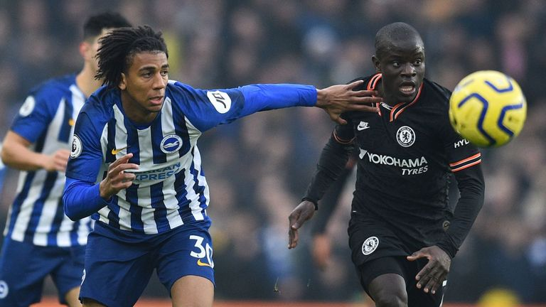 Brighton's Brazilian midfielder Bernardo (L) vies with Chelsea's French midfielder N'Golo Kante