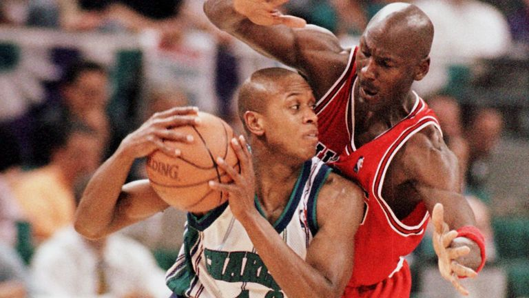 BJ Armstrong is guarded by his former team-mate Michael Jordan in the 1998 NBA playoffs