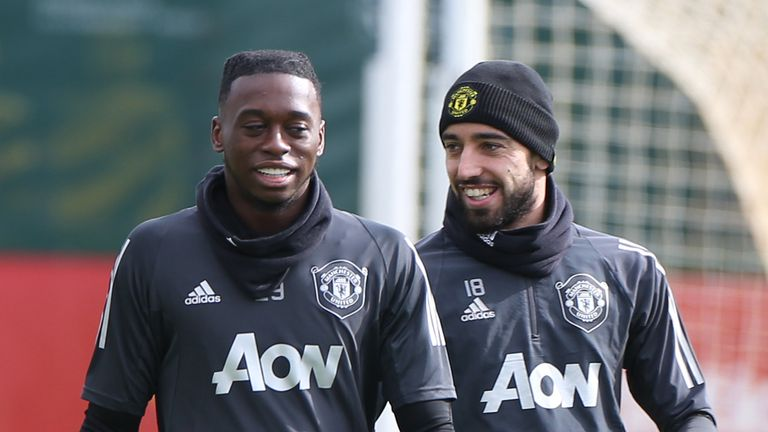 Aaron Wan-Bissaka and Bruno Fernandes of Manchester United in action during a first team training session at Aon Training Complex on March 11, 2020