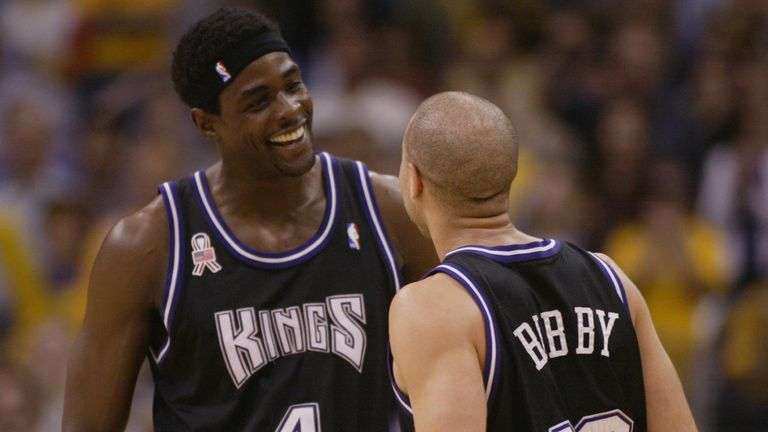 Chris Webber is congratulated by Sacramento Kings team-mate Mike Bibby