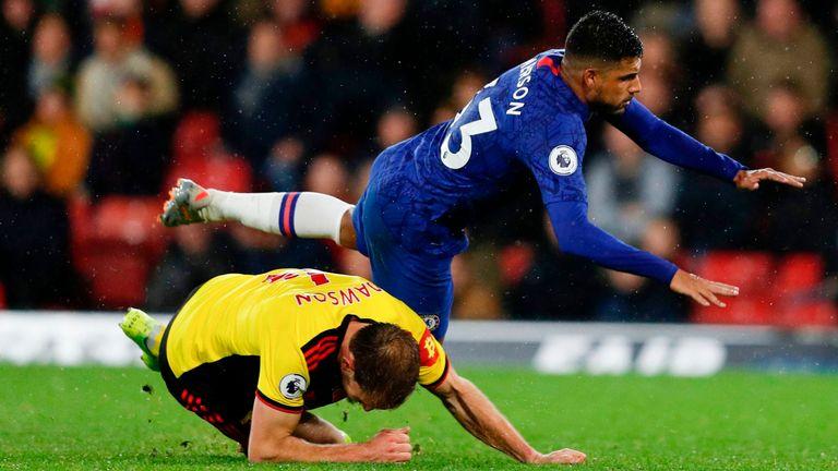 Watford's Craig Dawson tackles Chelsea's Emerson Palmieri at Vicarage Road