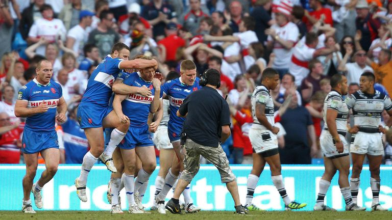 David Hodgson is mobbed by his team-mates after scoring the winning try