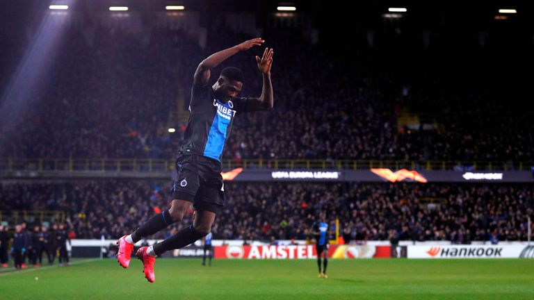 Club Brugge's Nigerian forward Dennis Emmanuel Bonaventure celebrates scoring his team's first goal, during the UEFA Europa League round of 32 first leg, football match between Club Brugge's and Manchester United, at the Jan Breydel Stadium in Bruges on February 20, 2020. (Photo by Adrian DENNIS / AFP) (Photo by ADRIAN DENNIS/AFP via Getty Images)