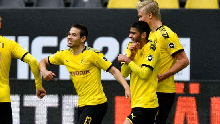 Guerreiro celebrates with team-mates after scoring Dortmund's second just before half-time