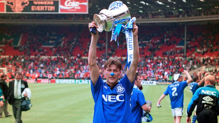 Used substitute Duncan Ferguson celebrates with the FA Cup at Wembley