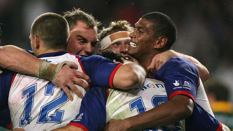 Great Britain celebrate scoring a try