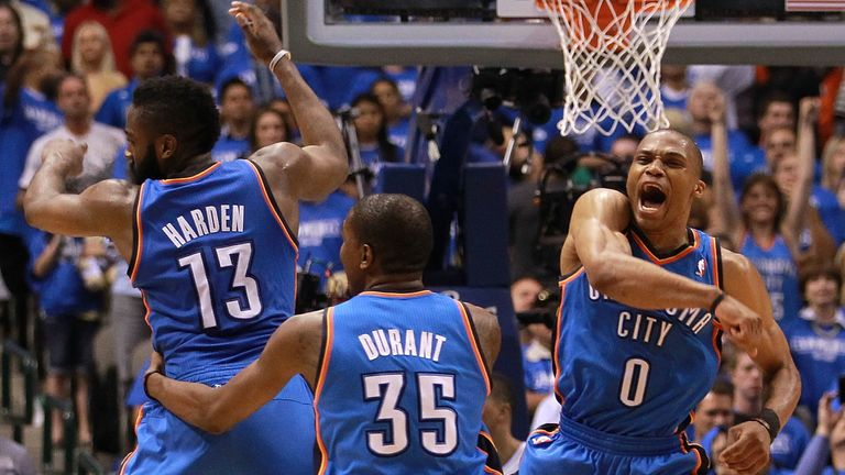 James Harden, Kevin Durant and Russell Westbrook of the Oklahoma City Thunder celebrate after scoring with 10 seconds against the Dallas Mavericks during Game Four of the Western Conference Quarterfinals in the 2012 NBA Playoffs