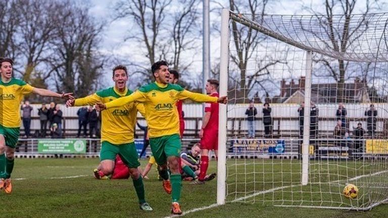 Dhillon celebrates while playing for his local team Hitchin Town
