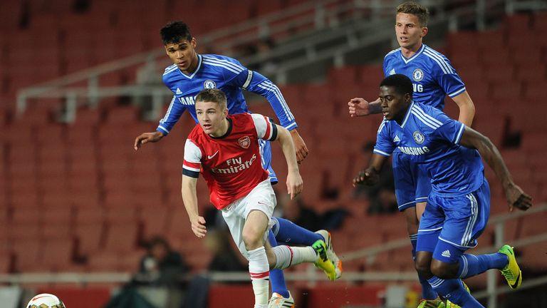 Daniel Crowley of Arsenal takes on Ruben Loftus-Cheek, Jordan Houghton and Isak Ssewankambo of Chelsea