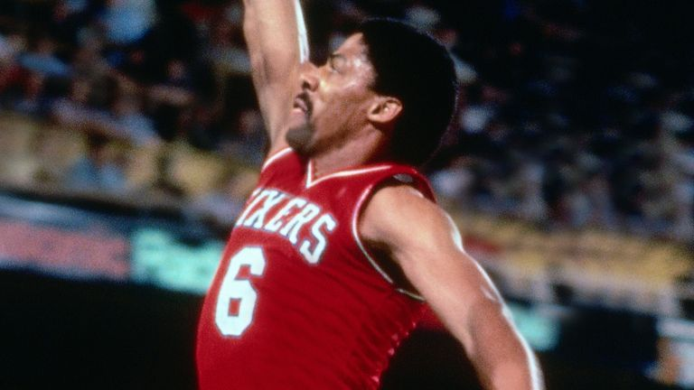 Julius Erving soars for a slam dunk against the Boston Celtics