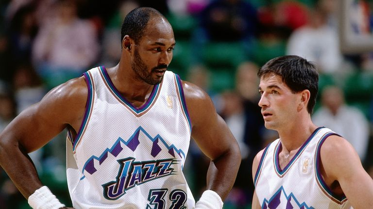 Karl Malone and John Stockton of the Utah Jazz talk strategy during a break in NBA game