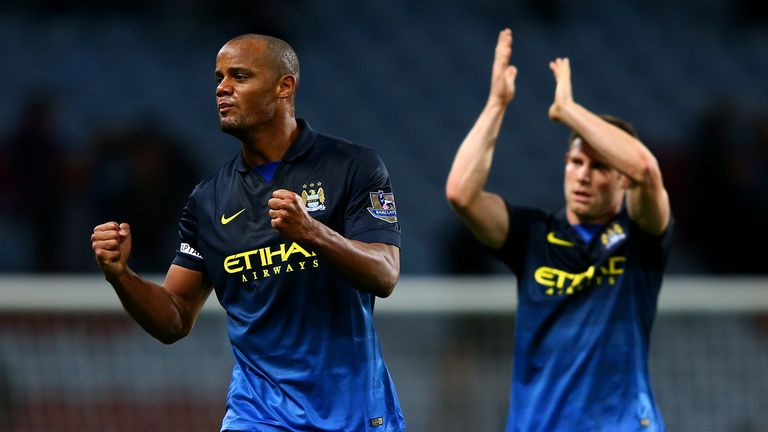 Vincent Kompany and James Milner during the Barclays Premier League match between Aston Villa and Manchester City at Villa Park on October 4, 2014 in Birmingham, England.