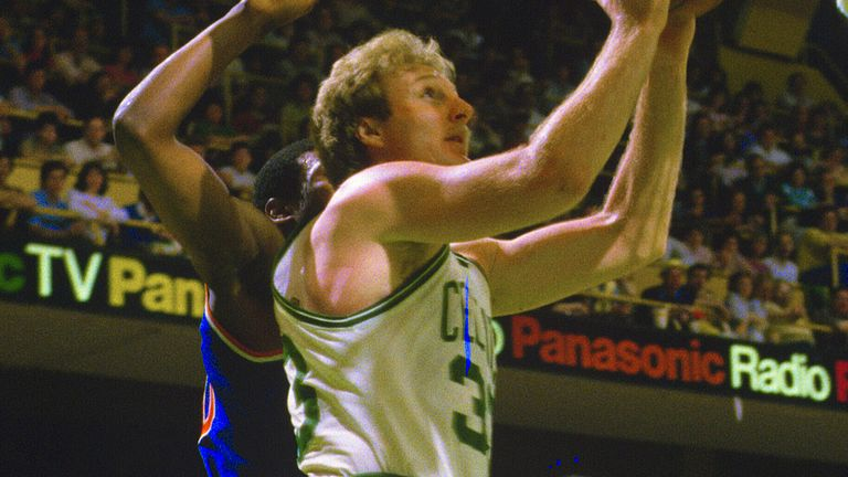 Larry Bird attacks the basket against the New York Knicks