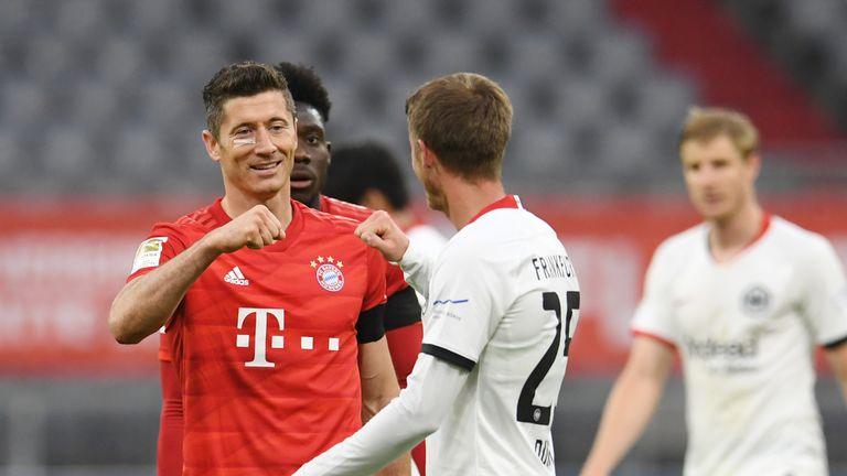 Robert Lewandowski of FC Bayern Munich interacts with Erik Durm of Eintracht Frankfurt after the Bundesliga match between FC Bayern Muenchen and Eintracht Frankfurt at Allianz Arena on May 23, 2020 in Munich, Germany.