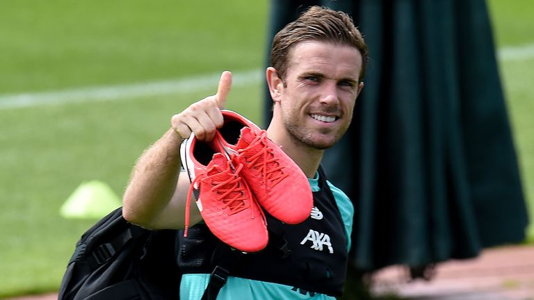 Liverpool captain Jordan Henderson gives the thumbs up as players returned to training