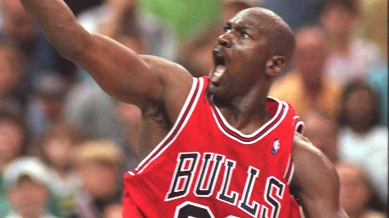 Michael Jordan elevates to the basket to score against the Charlotte Hornets