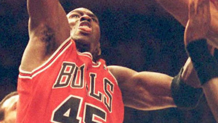 Michael Jordan scores over Patrick Ewing during the 'Double Nickel' game at Madison Square  Garden in March 1995
