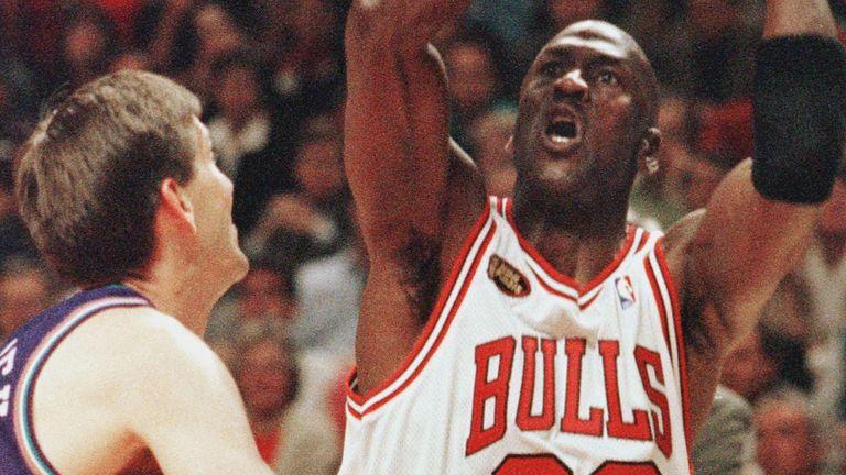 Michael Jordan shoots over Utah Jazz defender Jeff Hornacek in the 1998 NBA Finals